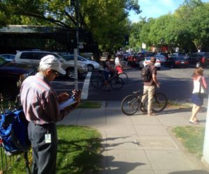 SABA volunteer Mark Tavianini counting bikes at H & 16th streets in downtown Sacramento