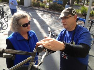 Bike Doc mechanic Glenn Small explains repairs to a Bike Doc customer.