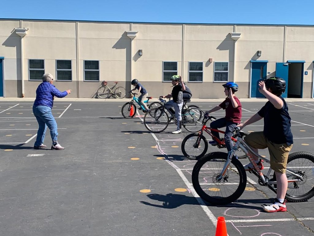 Students practice stopping and signaling skills with Arlete